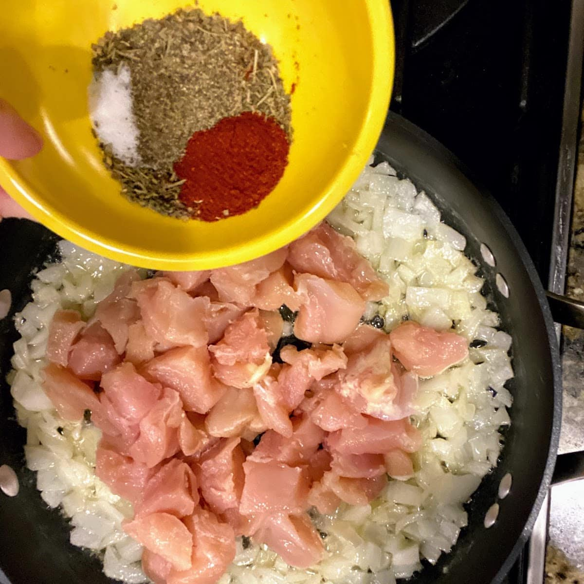 seasoning in bowl for Parmesan Chicken and Rice