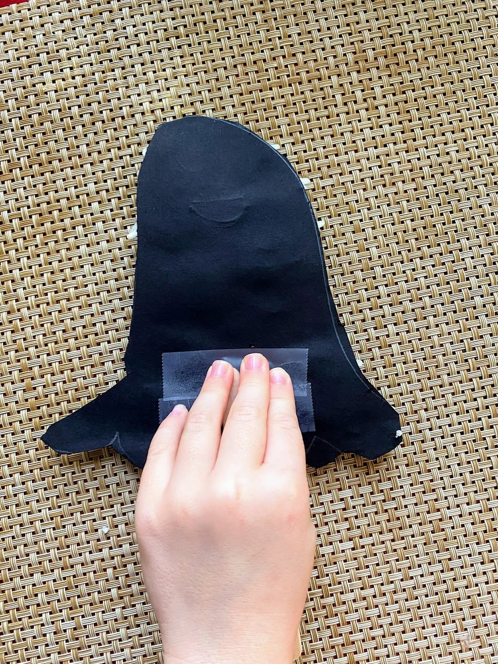 taping popcicle stick to Rice Ghost Craft