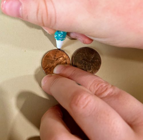 Tracing pennies for eyes for owl DIY napkin ring
