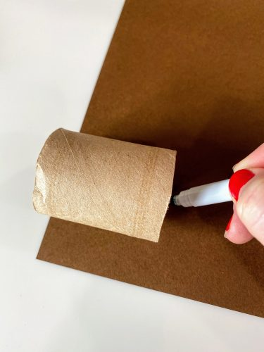 tracing brown paper to cover DIY napkin rings