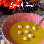 bowl of butternut squash soup with crackers