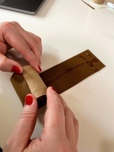 gluing brown paper to toilet paper roll2