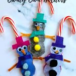 three snowman candy cane holders
