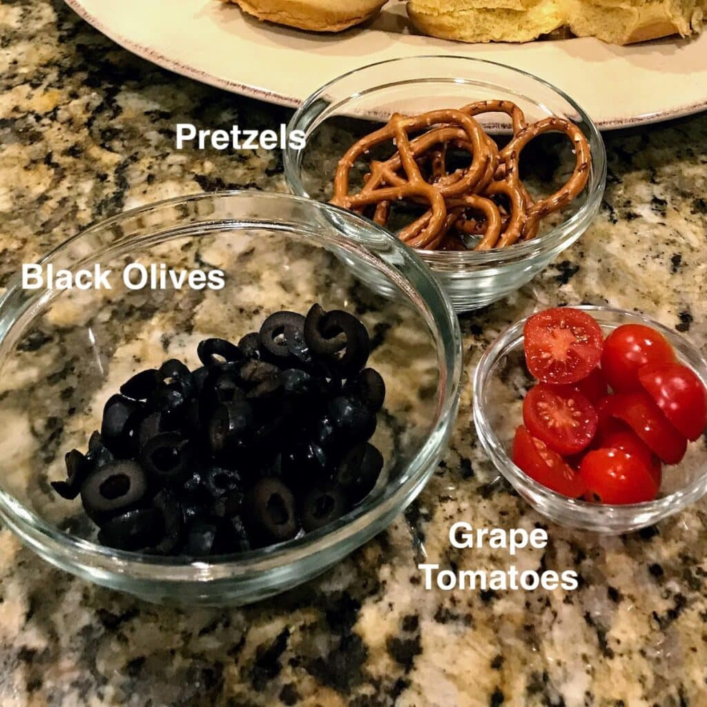 olives, pretzels and tomatoes for christmas sliders