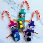 three snowmen candy cane holders
