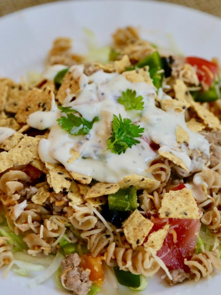 crunchy taco salad on a white plate