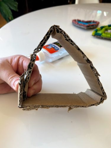 forming cardboard heart frame stand