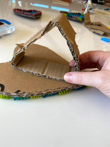 setting cardboard heart frame stand