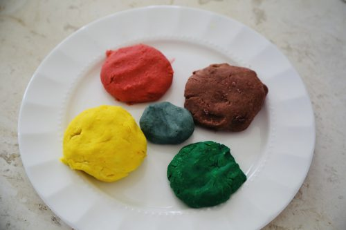 red, yellow, green, brown and gray balls of play dough