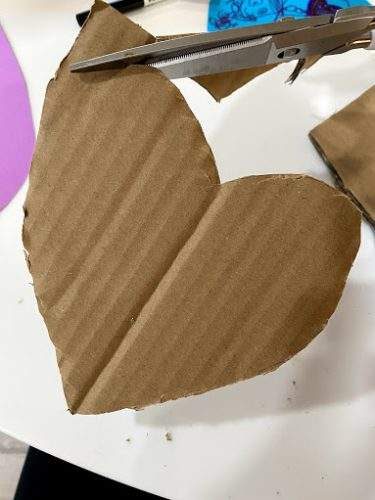 cutting cardboard heart