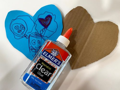 gluing heart to cardboard