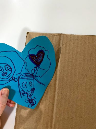 traced paper heart on cardboard