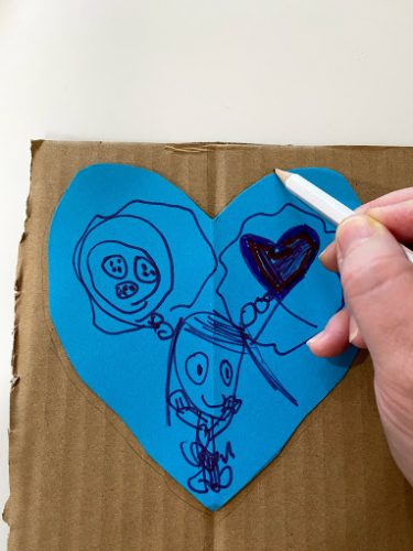 tracing paper heart on cardboard