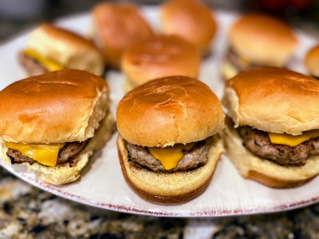 turkey burger sliders with cheese on a plate
