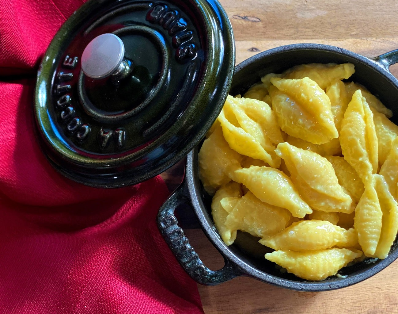 vegan mac and cheese in a mini cocotte with red napkin