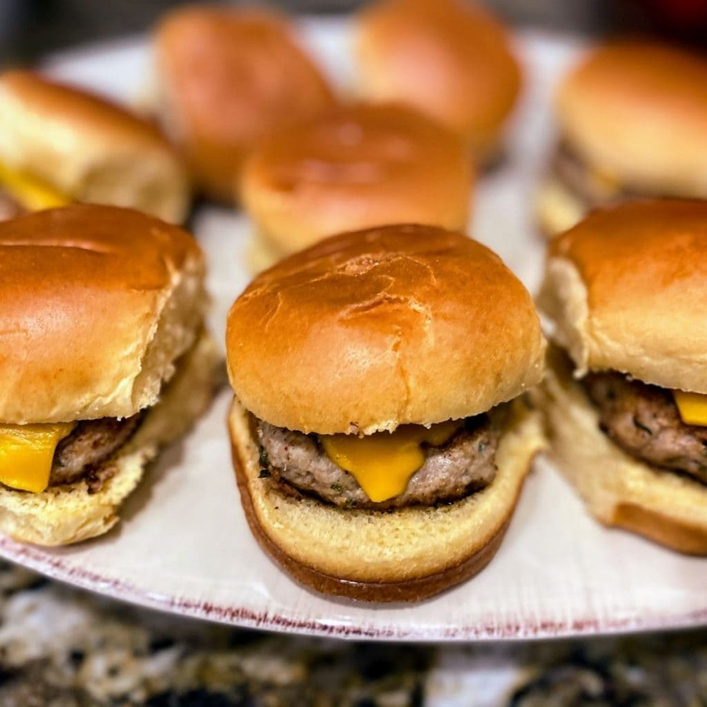 turkey burger sliders spread out on large plate