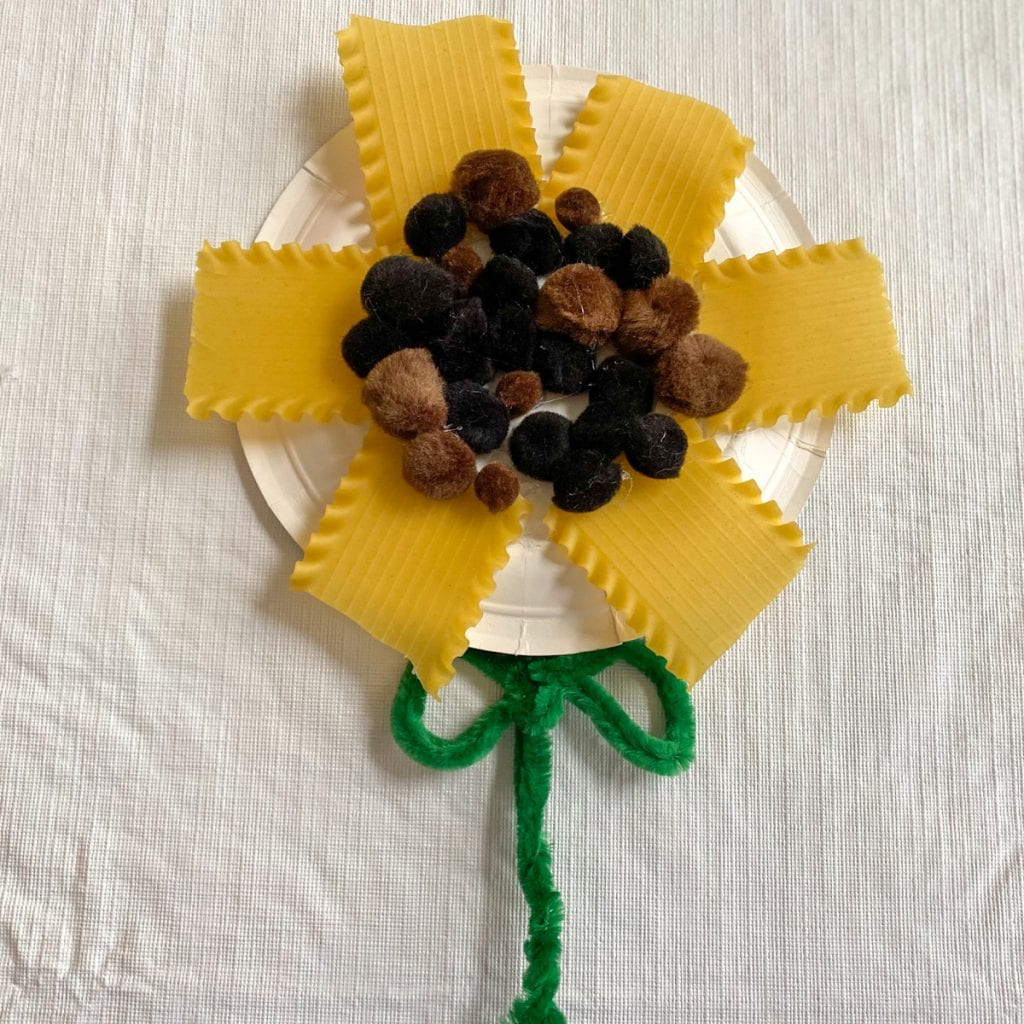 paper plate sunflower with pasta, pompoms and green pipe cleaners