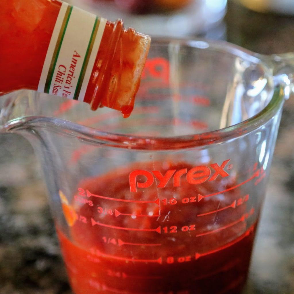 pouring chili sauce into pyrex
