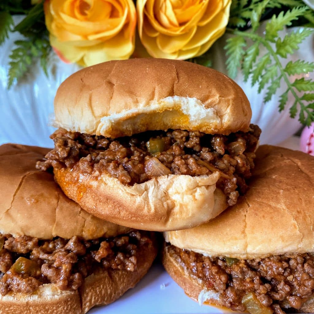 three sloppy joes stacked in buns