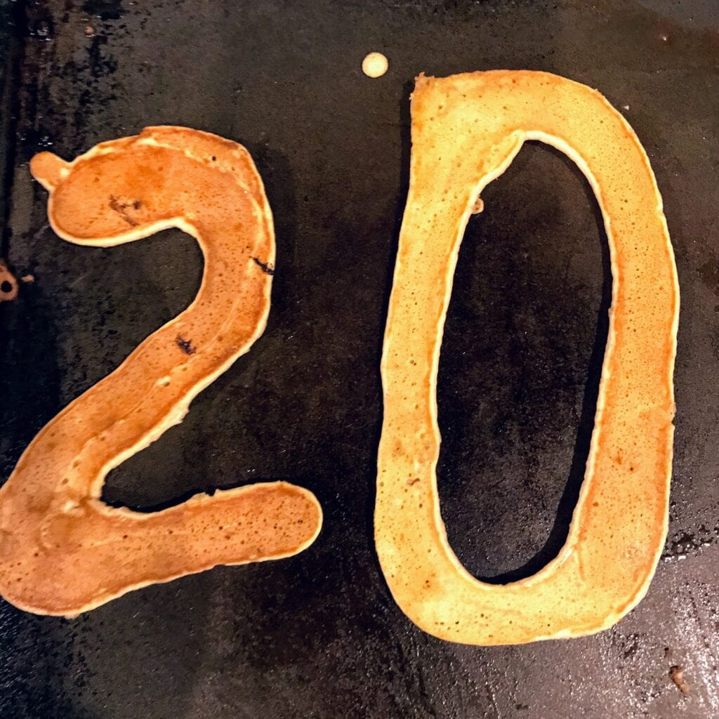 pancakes the shape of number 20 on griddle